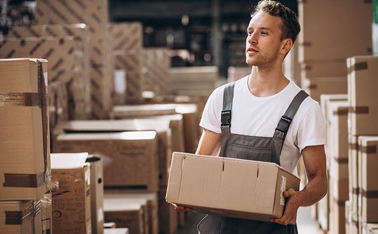 a man holding a box at a fulfillment centre